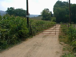 #1: The gate blocking Round Cove Road 2.5 miles from the confluence