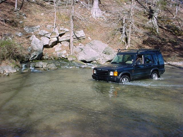 Fording Tom's Spring on the approach. Note the water pouring out of the base of the rock.