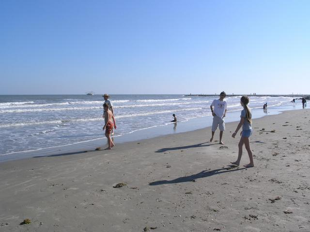 Playing on the beach, looking towards the point