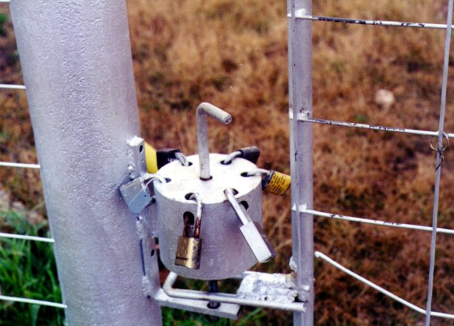 Rotary lock selector on probable access gate.