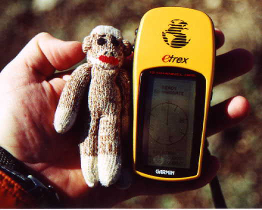Chango the Sock Monkey verifies the correct coordinates on the GPS