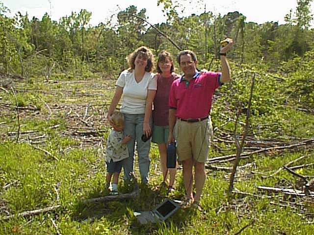 The family poses at the site
