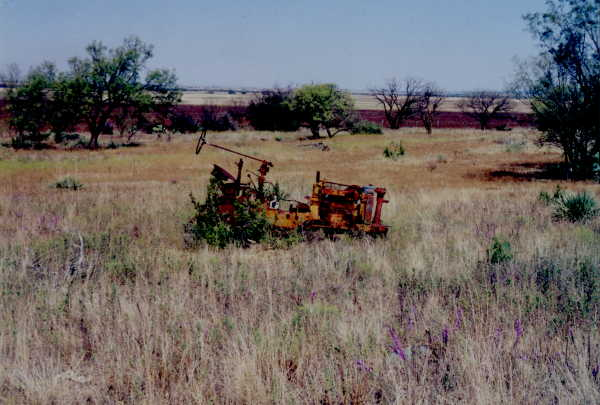 Tractor in retirement east of confluence.