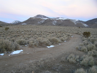 #1: Site of 40 North 112 West, looking west.  The confluence lies 4 meters to the left of the trail, to the left of the lone tree in the center right of the photograph.