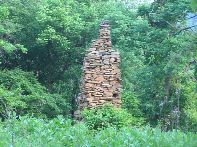 Nearest sign of humans to confluence--abandoned chimney 150 meters south of confluence.