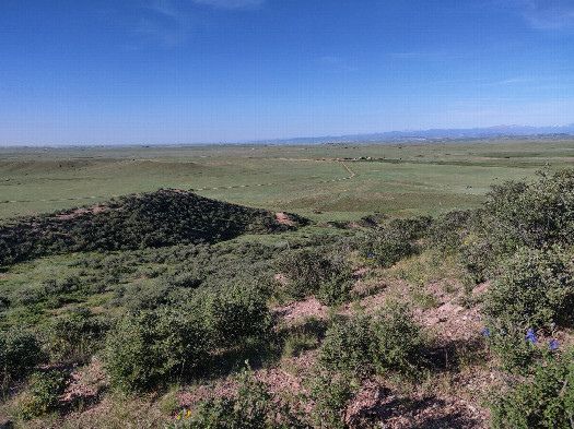#1: After climbing to highest point, this is the view back to the South, looking toward Fort Collins, CO in the distance.