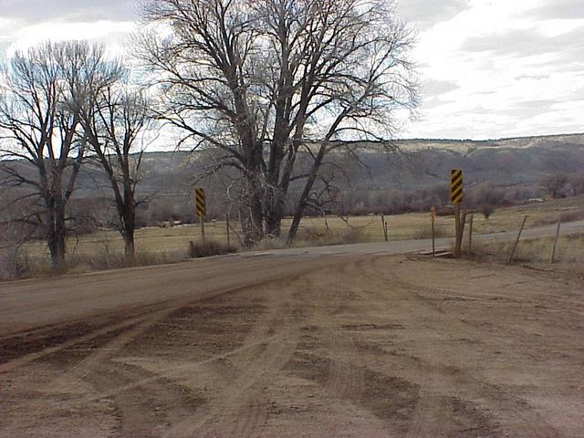 Looking from Colorado to Wyoming at the state line cattle guard and the starting point of the hike.