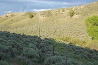 #12: The fence that marks the Wyoming-Colorado state line, about 0.2 miles from the confluence point.  (Wyoming is on the left; Colorado is on the right.)