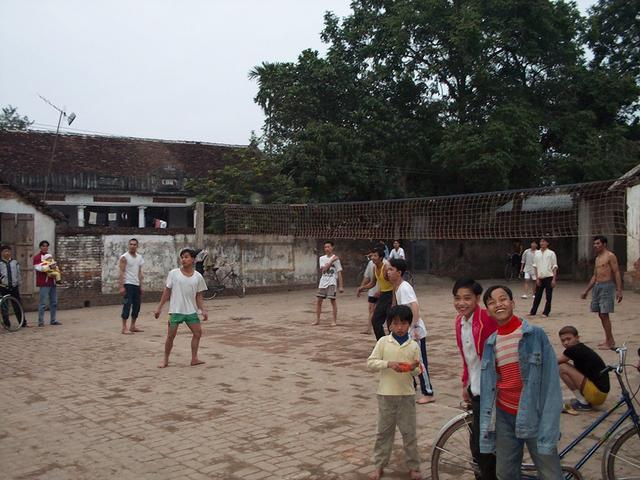 People of the village of Tan Nguy play volleyball