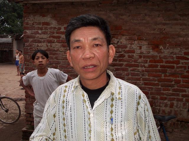 Angry Vietnamese man with alcohol on his breath