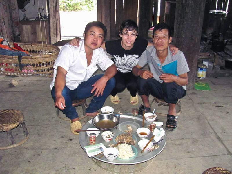 Natie with 2 of the local villagers the next morning after a breakfast of rice, chicken and homemade alcohol.