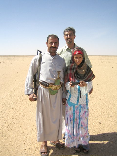 Tal`at, Yasmin, and `Abdullah with the Kalashnikov!