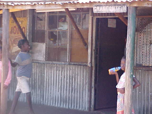 Grasfontein General store with two children