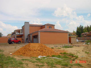 #1: General view of the house looking South, showing the garage which is the location of the Confluence.