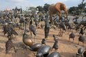 #7: Roadside metal sculptures by Zimbabwean refugees ranging from owls to elephant