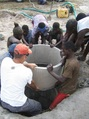 #8: Villagers taking part in the construction of their well